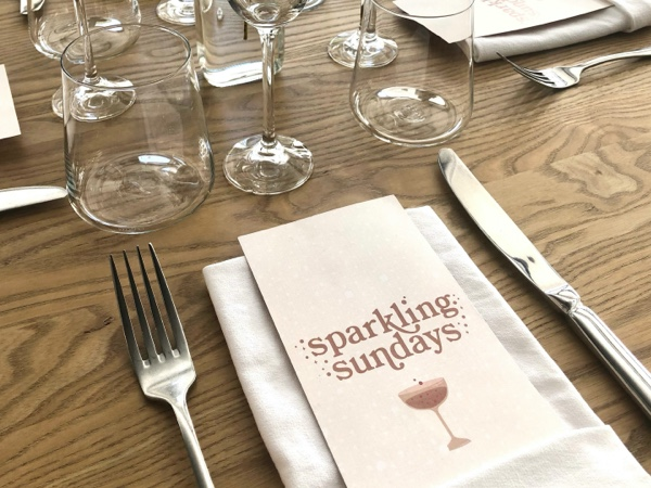 ORZO Event - Sparkling Sundays , flyer on the table